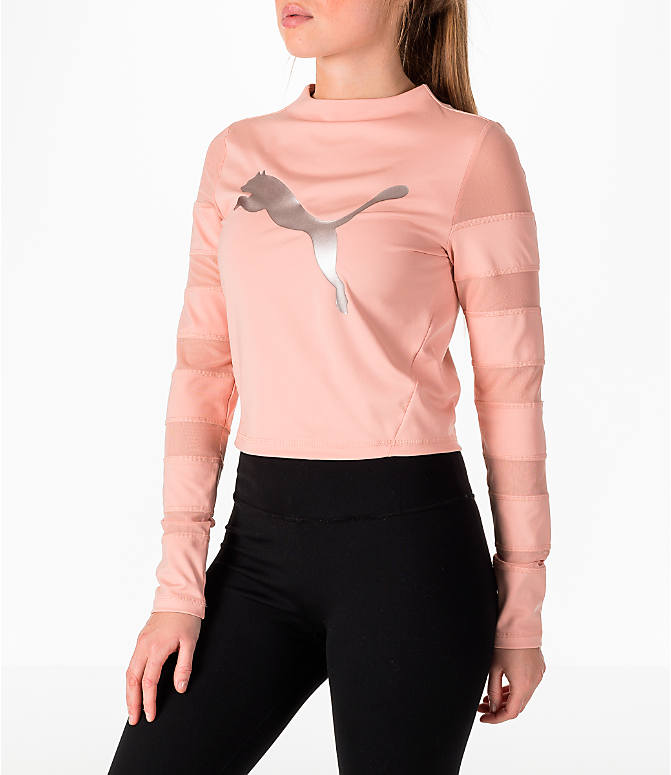 Front Three Quarter view of Women's Puma Mesh Insert Long-Sleeve Training Shirt in Peach/Pearl
