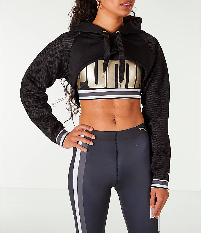 Front view of Women's Puma Ambition Long Sleeved Cropped Hoodie in Black/Gold