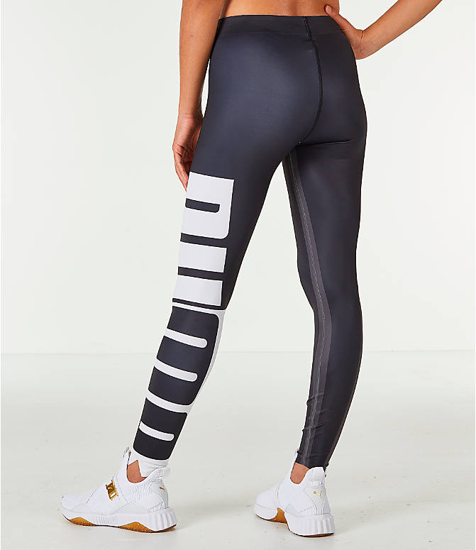 Back Left view of Women's Puma Varsity Tights in Black/Gold