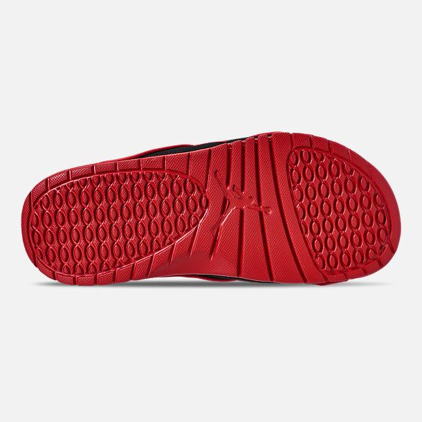 f7c86cb64e2027 Bottom view of Men s Jordan Hydro 4 Retro Slide Sandals in White Fire Red