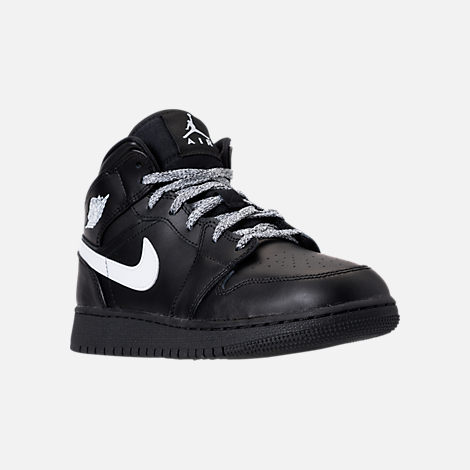 Three Quarter view of Big Kids' Air Jordan 1 Mid Basketball Shoes in Black/White/Black