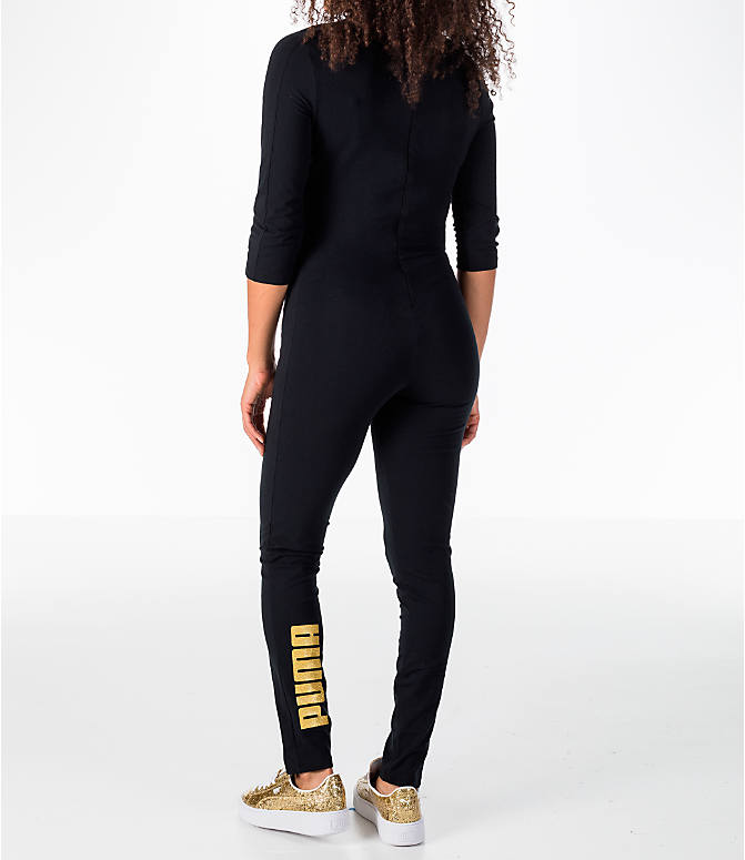 Back Left view of Women's Puma T7 Jumpsuit in Black/Gold