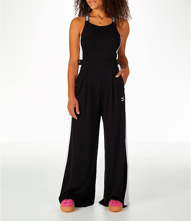 Front Three Quarter view of Women's Puma Archive T7 Overall Jumpsuit in Black/White