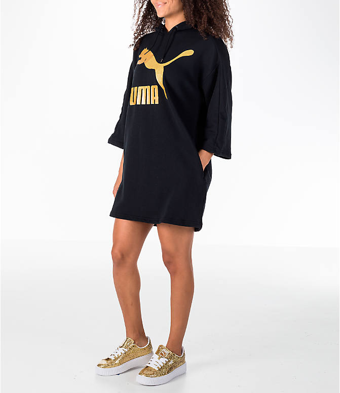 Front Three Quarter view of Women's Puma Glam Oversized Hooded Dress in Black/Gold