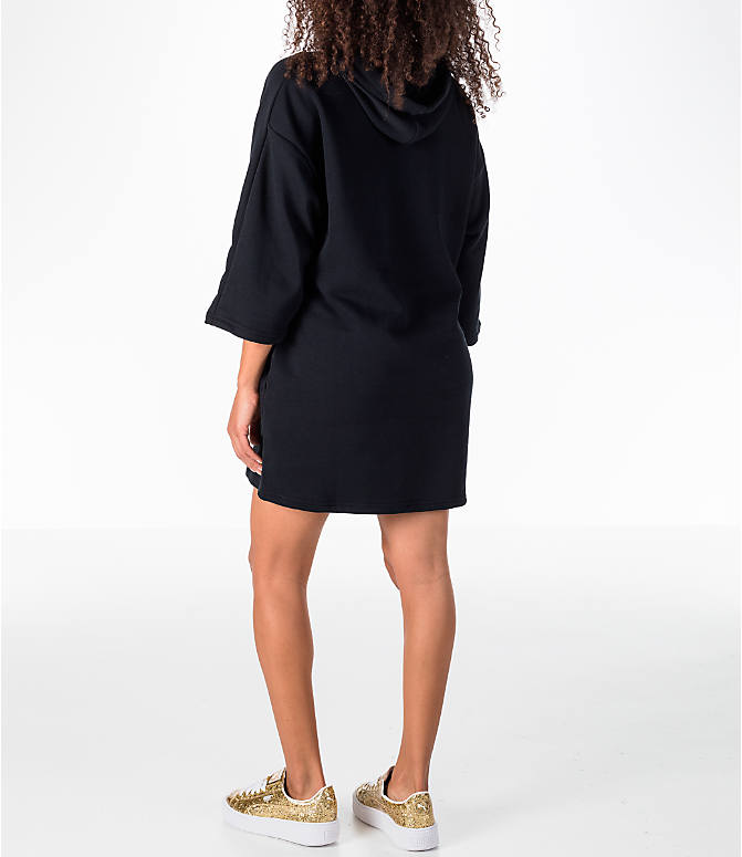 Back Left view of Women's Puma Glam Oversized Hooded Dress in Black/Gold