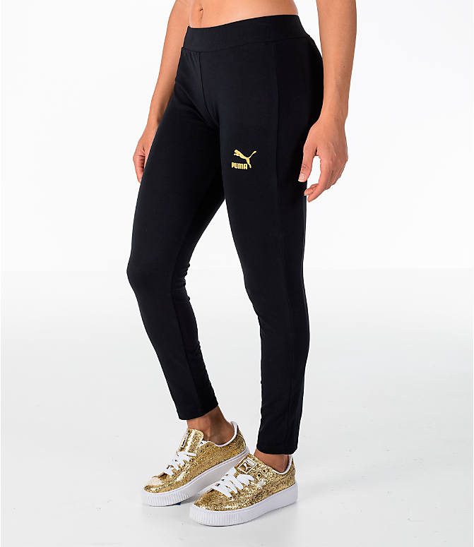 Front Three Quarter view of Women's Puma Glam Leggings in Black/Gold