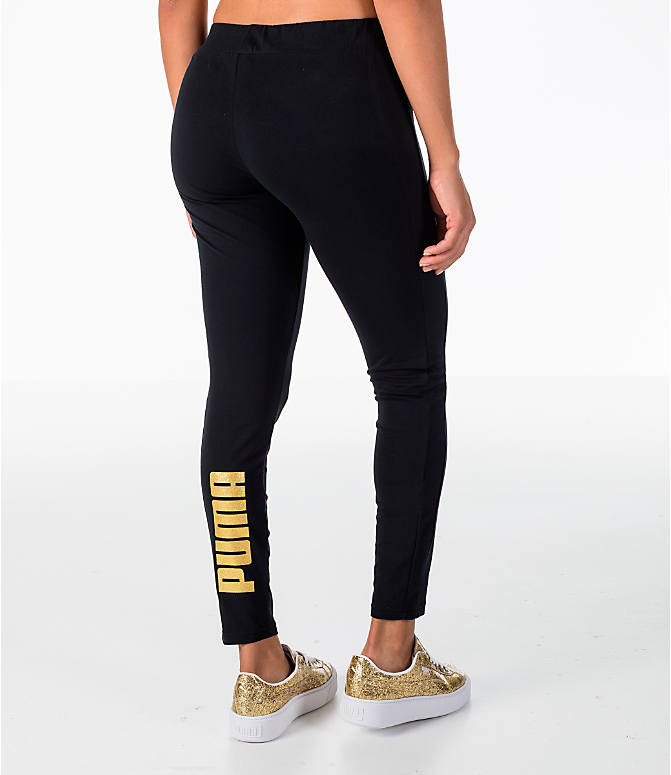 Back Right view of Women's Puma Glam Leggings in Black/Gold
