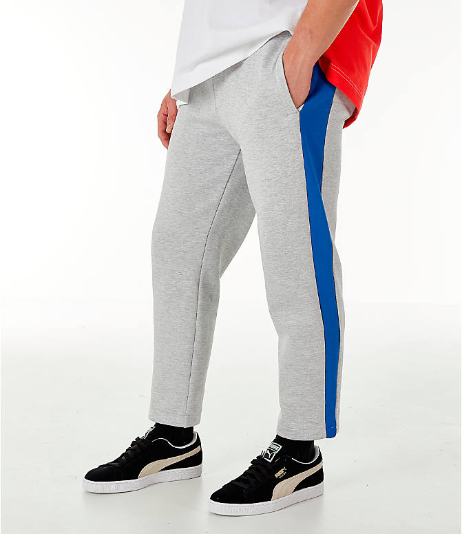 Front view of Men's PUMA x PEPSI Track Pants in Light Grey Heather