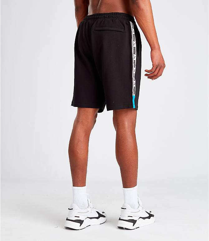 Back Right view of Men's Puma XTG Shorts in Black