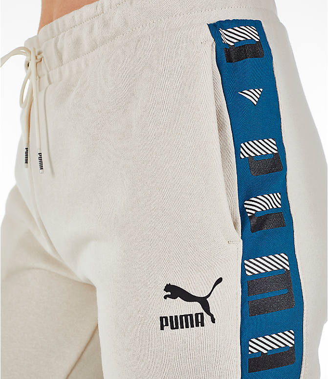 Detail 1 view of Women's Puma Revolt Terry Sweatpants in Birch/White