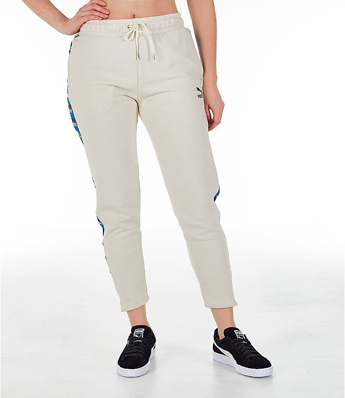 Front Three Quarter view of Women's Puma Revolt Terry Sweatpants in Birch/White