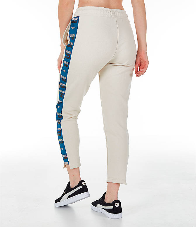 Back Left view of Women's Puma Revolt Terry Sweatpants in Birch/White