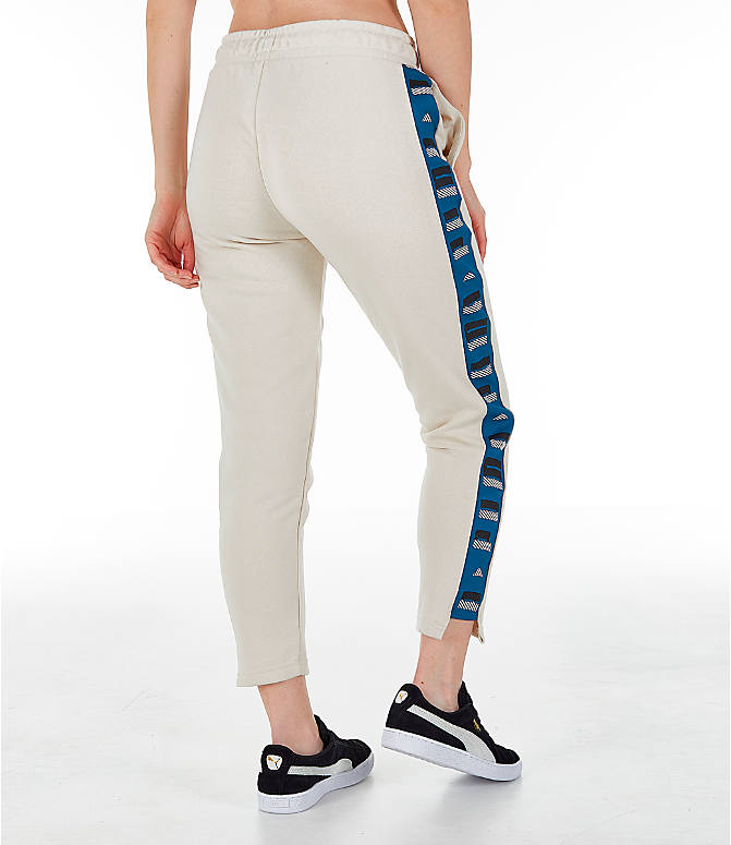 Back Right view of Women's Puma Revolt Terry Sweatpants in Birch/White