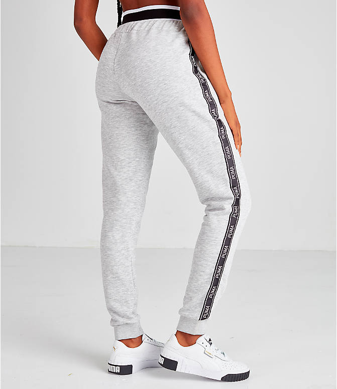 Back Right view of Women's Puma Tape Waistband Jogger Pants in Black