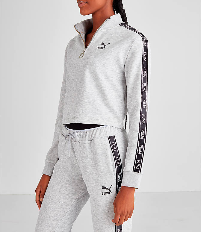 Front Three Quarter view of Women's Puma Tape Quarter-Zip Shirt in White/Black