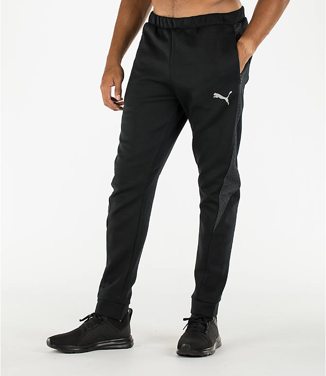 Front Three Quarter view of Men's Puma Evo Stripe Jogger Pants in Black