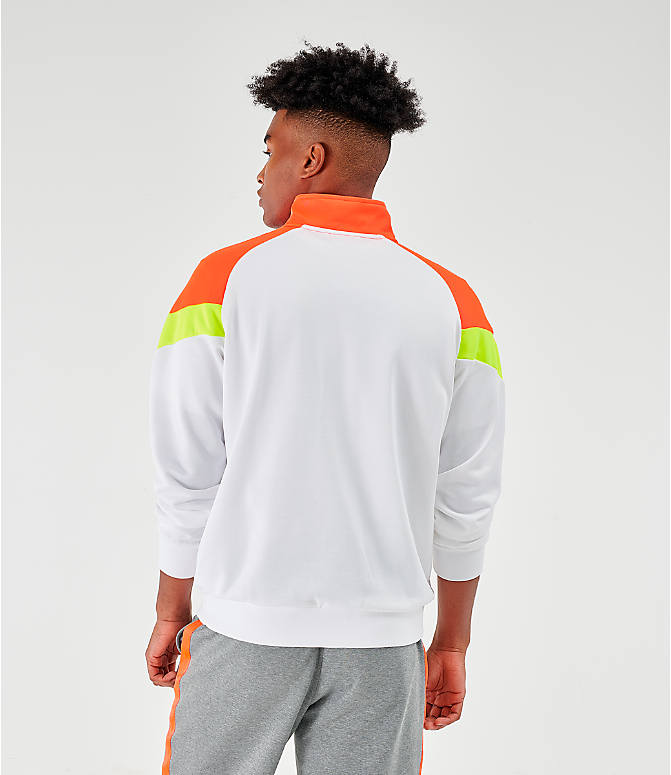 Back Left view of Men's Puma Iconic MCS Track Jacket in White/Orange