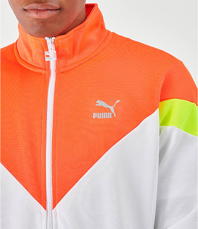 Back Right view of Men's Puma Iconic MCS Track Jacket in White/Orange