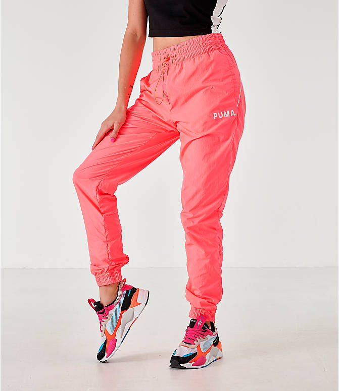 Front view of Women's Puma Chase Woven Jogger Pants in Pink Alert