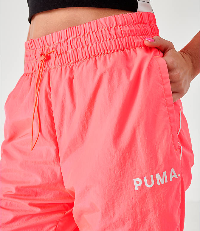 Back Right view of Women's Puma Chase Woven Jogger Pants in Pink Alert