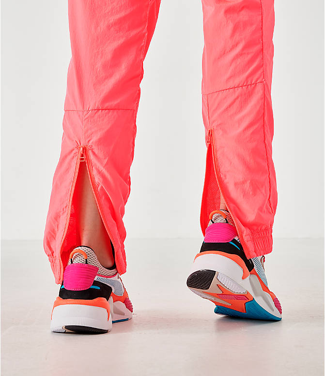 On Model 5 view of Women's Puma Chase Woven Jogger Pants in Pink Alert