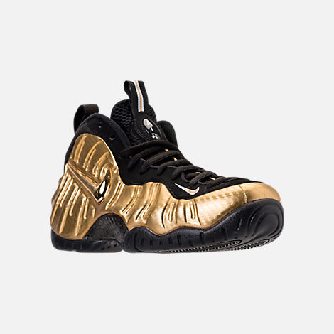 Three Quarter view of Men's Nike Air Foamposite Pro Basketball Shoes in Metallic Gold/Black/White