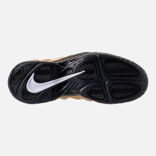 Bottom view of Men's Nike Air Foamposite Pro Basketball Shoes in Metallic Gold/Black/White