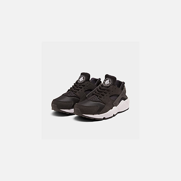 Three Quarter view of Women's Nike Air Huarache Casual Shoes in Black/White