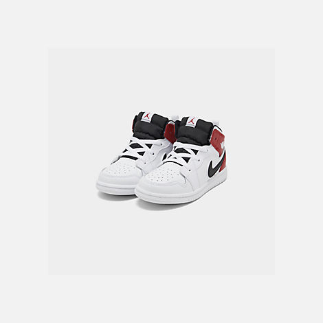 Three Quarter view of Kids' Toddler Air Jordan 1 Mid Retro Basketball Shoes in White/Black/Gym Red