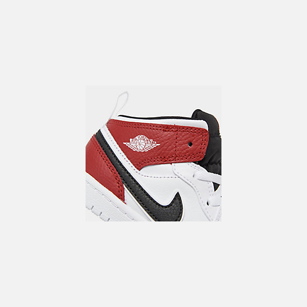 Front view of Kids' Toddler Air Jordan 1 Mid Retro Basketball Shoes in White/Black/Gym Red