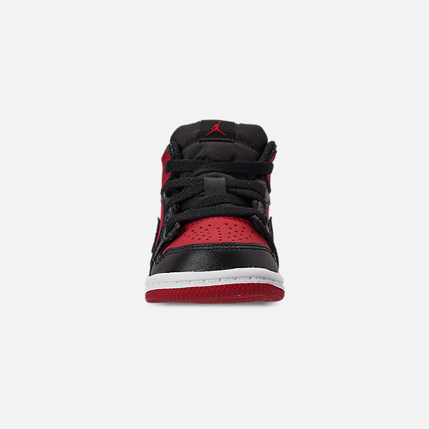 sports shoes 33ced b670b Front view of Kids  Toddler Air Jordan 1 Mid Retro Basketball Shoes in Gym  Red