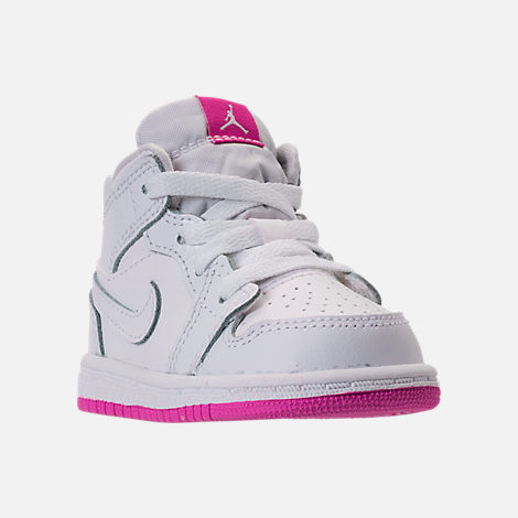 Three Quarter view of Girls' Toddler Jordan 1 Mid Basketball Shoes in White/Fuchsia Blast