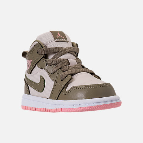 Three Quarter view of Girls' Toddler Air Jordan 1 Mid Basketball Shoes in Trooper/Bleached Coral/Light Orewood Brown