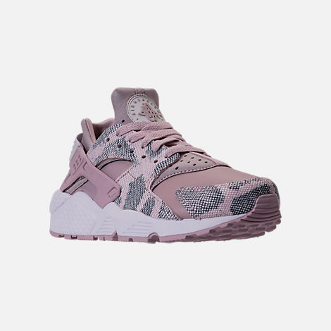 Three Quarter view of Women's Nike Air Huarache Run Premium Running Shoes in Particle Rose/Vast Grey