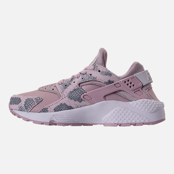 Left view of Women's Nike Air Huarache Run Premium Running Shoes in Particle Rose/Vast Grey