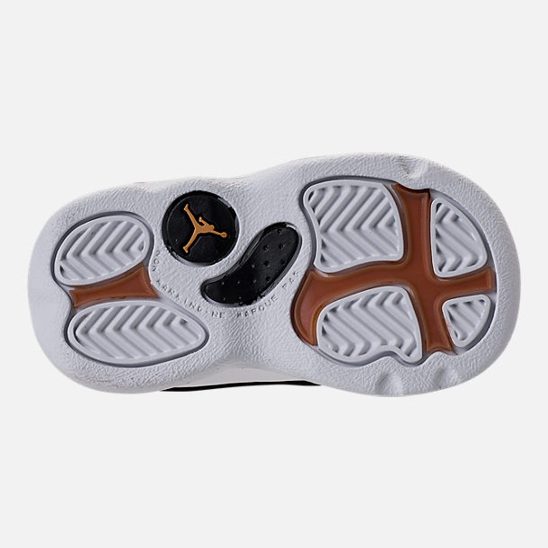 Bottom view of Kids' Toddler Air Jordan Retro 13 Basketball Shoes in Black/Metallic Gold/White/Gum Med