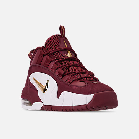 Three Quarter view of Men's Nike Air Max Penny Basketball Shoes in Team Red/Metallic Gold/Summit White