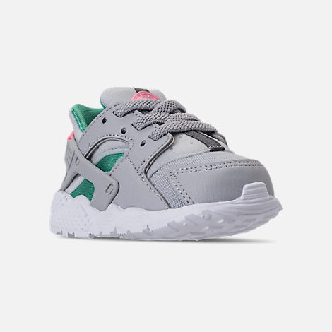 Three Quarter view of Kids' Toddler Nike Huarache Run Running Shoes in WOlf Grey/Sunset Pulse/Kinetic Green