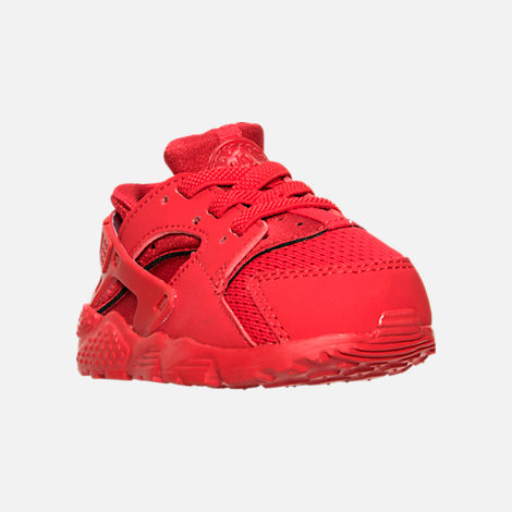 Three Quarter view of Boys' Toddler Nike Huarache Run Running Shoes in University Red/University Red