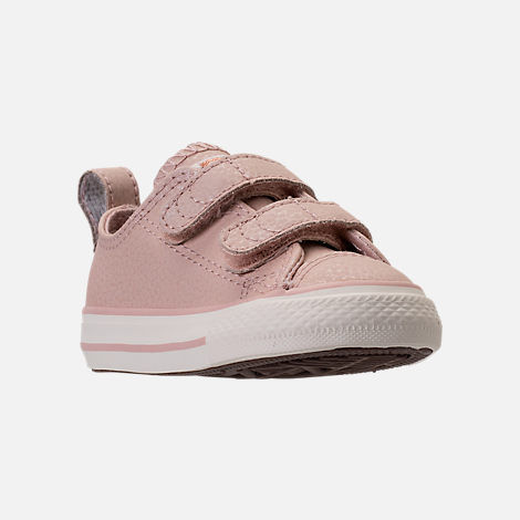Three Quarter view of Girls' Toddler Converse Chuck Taylor Ox Leather Hook-and-Loop Strap Casual Shoes in Particle Beige/Egret/Rose