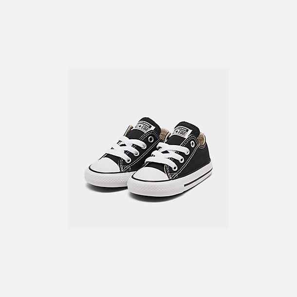 Three Quarter view of Kids' Toddler Converse Chuck Taylor Low Top Casual Shoes in Black
