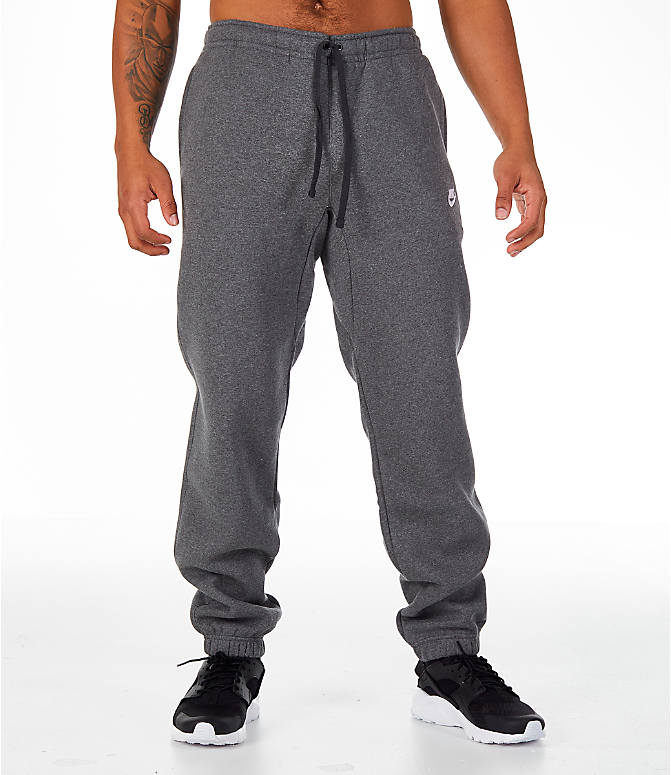 Front Three Quarter view of Men's Nike Club Fleece Jogger Pants in Grey