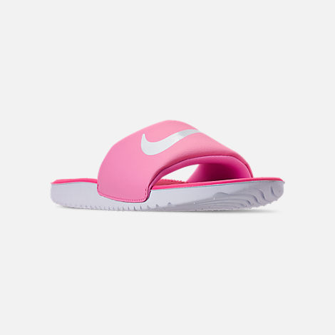Three Quarter view of Girls' Big Kids' Nike Kawa Slide Sandals in Psychic Pink/White/Laser Fuchsia