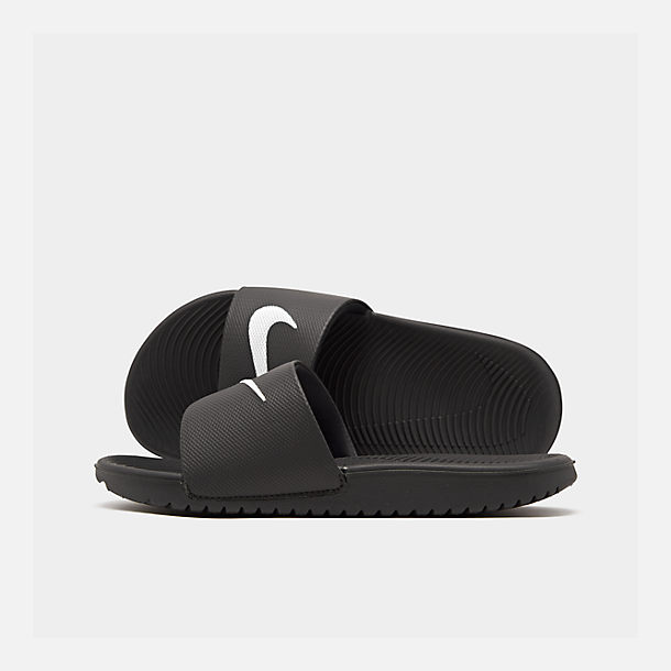 Right view of Boys' Grade School Nike Kawa Slide Sandals in Black/White