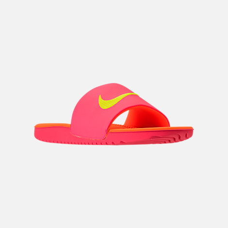 Three Quarter view of Boys' Grade School Nike Kawa Slide Sandals in Hot Punch/Volt/Total Orange