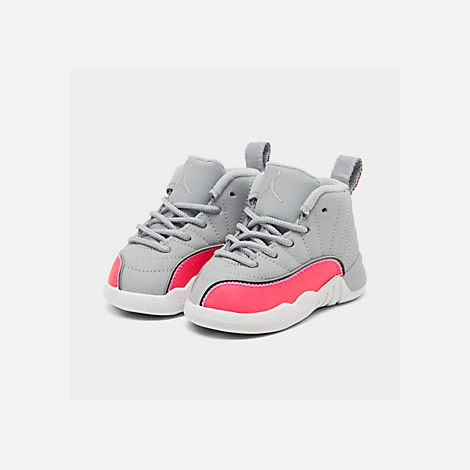Three Quarter view of Girls' Toddler Air Jordan Retro 12 Basketball Shoes in Wolf Grey/Racer Pink/Black