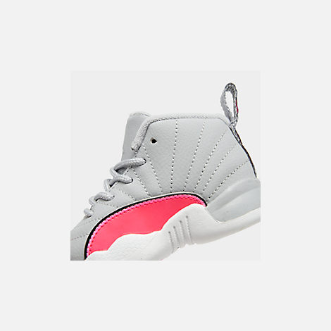 Front view of Girls' Toddler Air Jordan Retro 12 Basketball Shoes in Wolf Grey/Racer Pink/Black