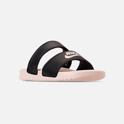 Three Quarter view of Women's Nike Benassi Duo Ultra Slide Sandals in Black/Guava Ice/Guava Ice