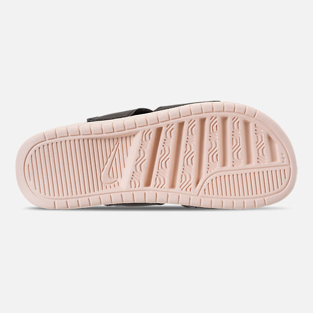 Bottom view of Women's Nike Benassi Duo Ultra Slide Sandals in Black/Guava Ice/Guava Ice