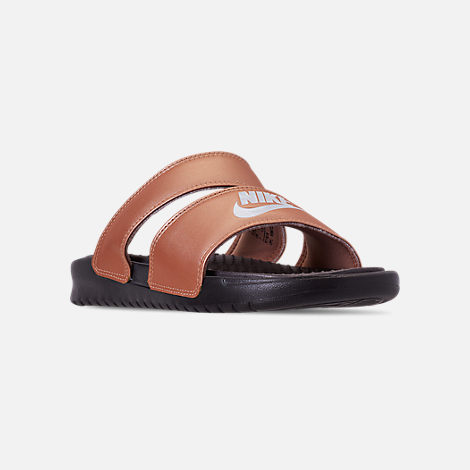 ec6b92eae24 Three Quarter view of Women s Nike Benassi Duo Ultra Slide Sandals in Metallic  Red Bronze